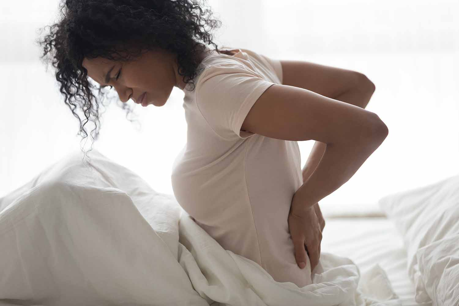What causes postpartum back pain and how to fix it